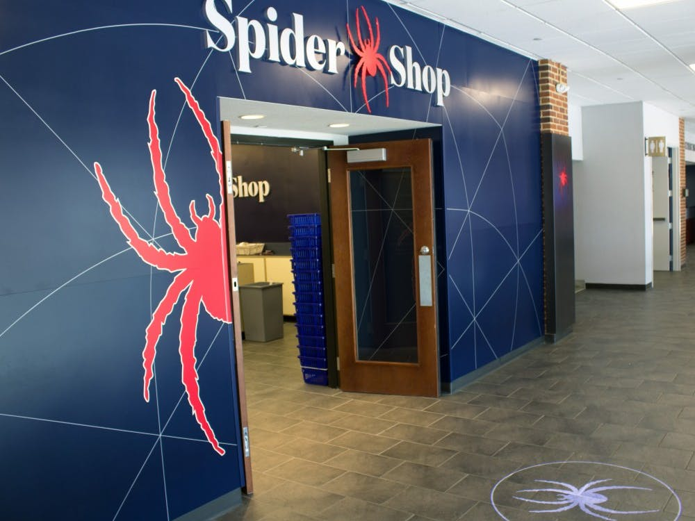 The entrance to the SpiderShop, located in Tyler Haynes Commons, features a projected spider image on the ground.