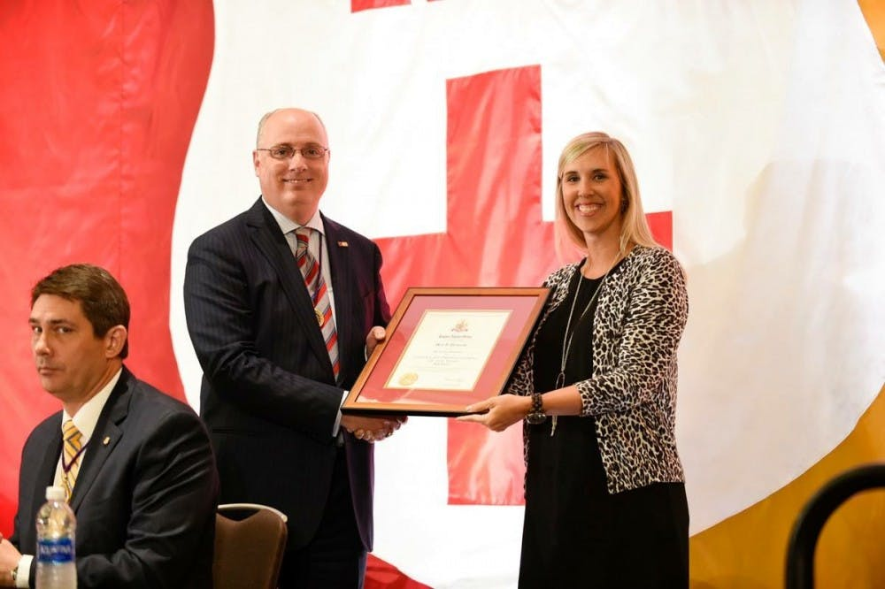 <p>Meg Pevarski, director of Greek life, receiving her award from the national Kappa Alpha Order. <em>Photo courtesy of the national Kappa Alpha Order's Facebook page.</em></p>