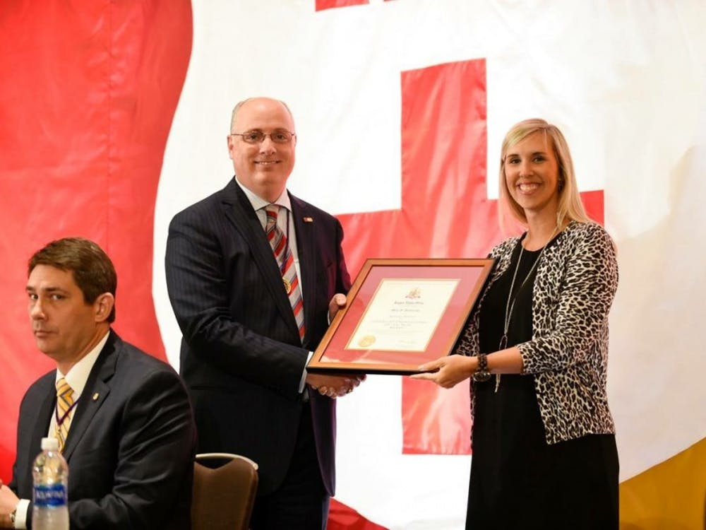 Meg Pevarski, director of Greek life, receiving her award from the national Kappa Alpha Order. Photo courtesy of the national Kappa Alpha Order's Facebook page.