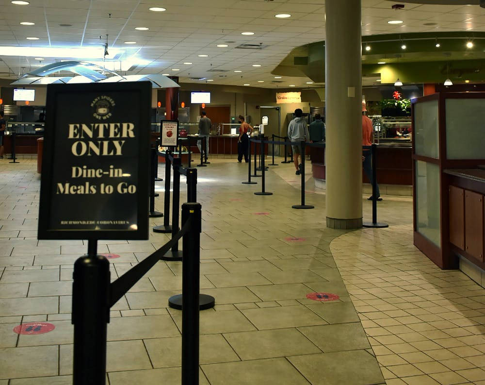 <p>Rope barriers and signs lead diners through the stations at the Heilman Dining Center in a socially distanced manner.&nbsp;</p>