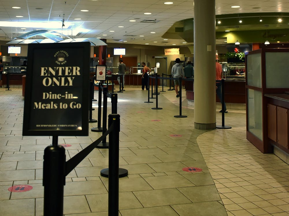 Rope barriers and signs lead diners through the stations at the Heilman Dining Center in a socially distanced manner.