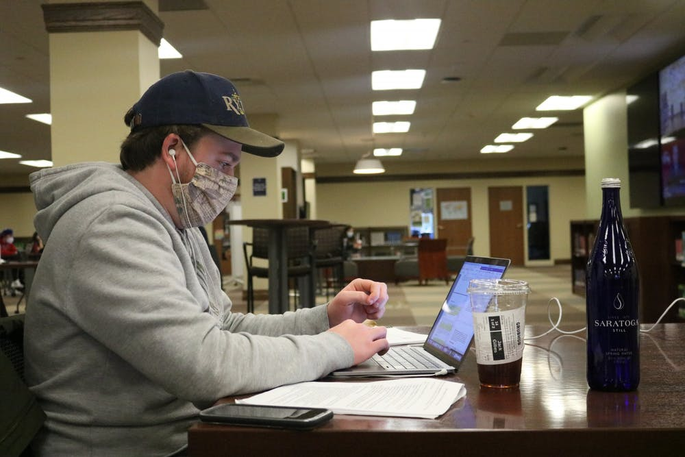 <p>A student works at a desk in Boatwright Memorial Library.</p>