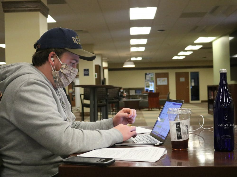 A student works at a desk in Boatwright Memorial Library.