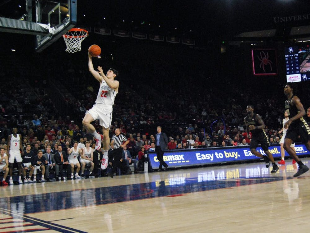 First-year guard Andre Gustavson drives to the basket Saturday, Dec. 1, in a victory over Wake Forest.