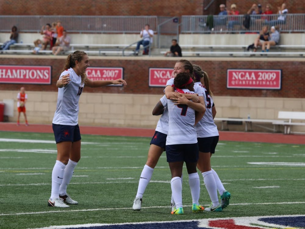 Keaira Clark celebrates with her teammates after scoring the lone goal in Sunday's game against UMass.