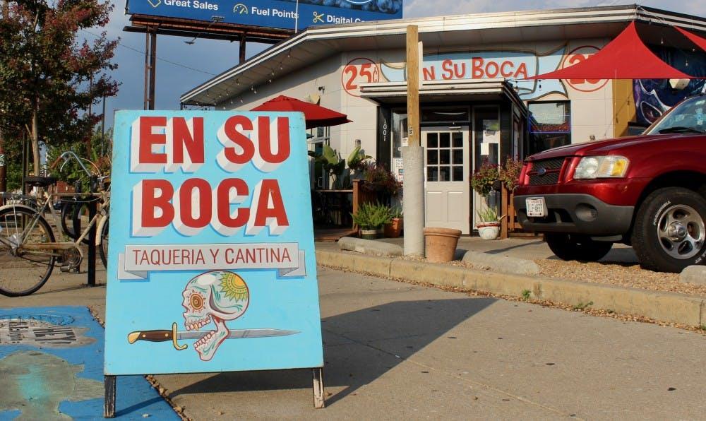 <p>An eye-catching sign stands outside En Su Boca.&nbsp;</p>