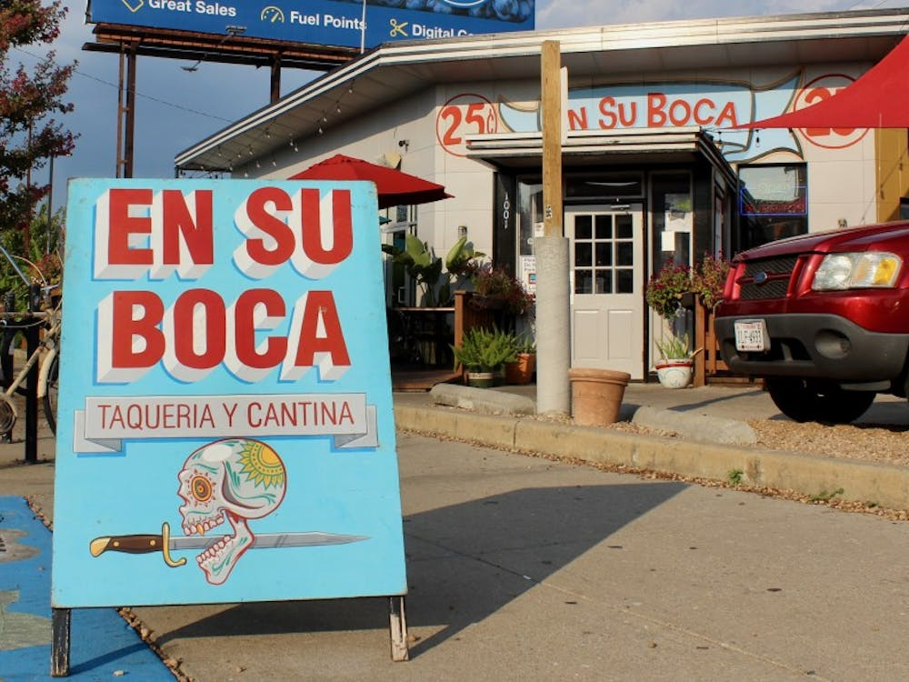 An eye-catching sign stands outside En Su Boca.