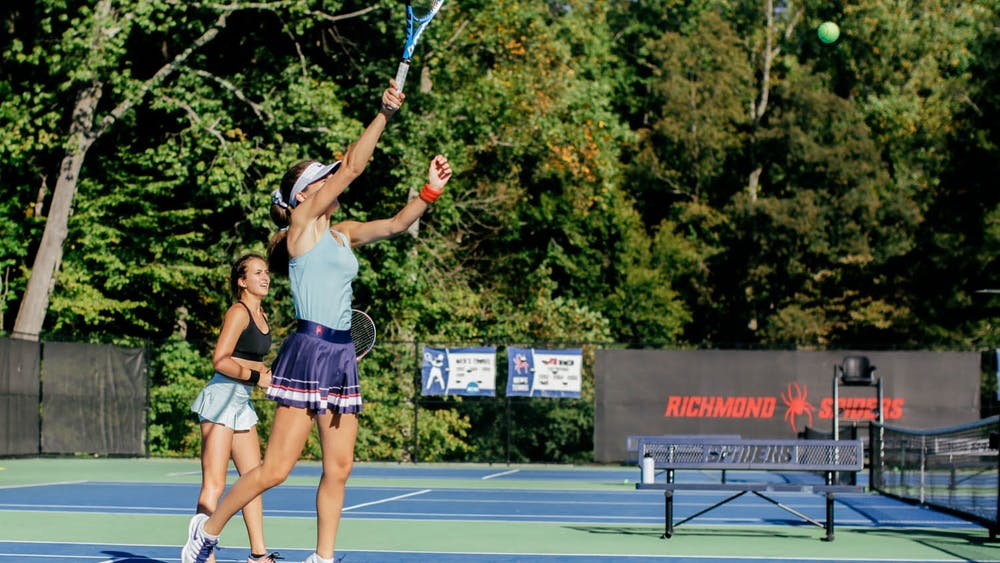 Freshman Sara Salemyr fires a ball across the net during a doubles practice with sophomore Andrea Campodonico.