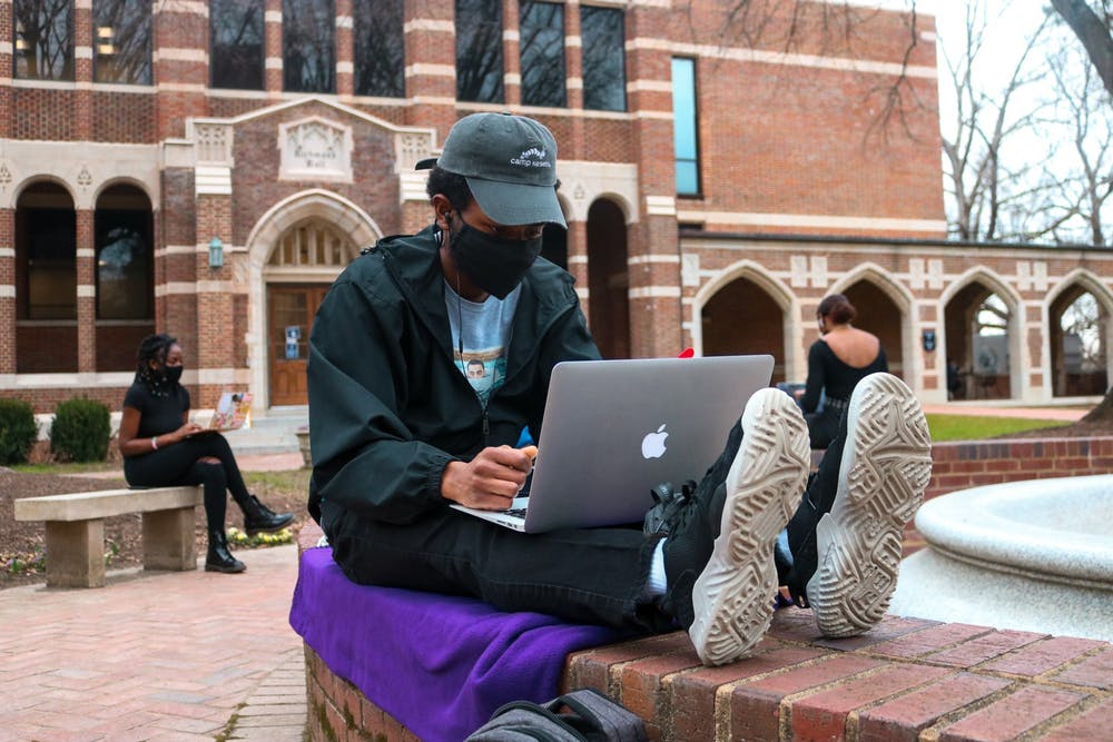 <p>Junior Cameron Keeley-Parker gathers in the Stern quadrangle for the teach-in protest.</p>
