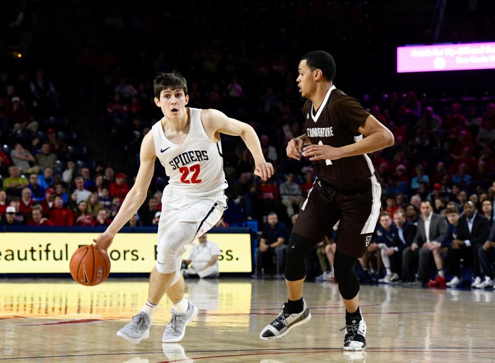 <p>First-year guard Andre Gustavson drives the ball down the court in a losing game against St. Bonaventure on Saturday, Jan. 26.&nbsp;</p>