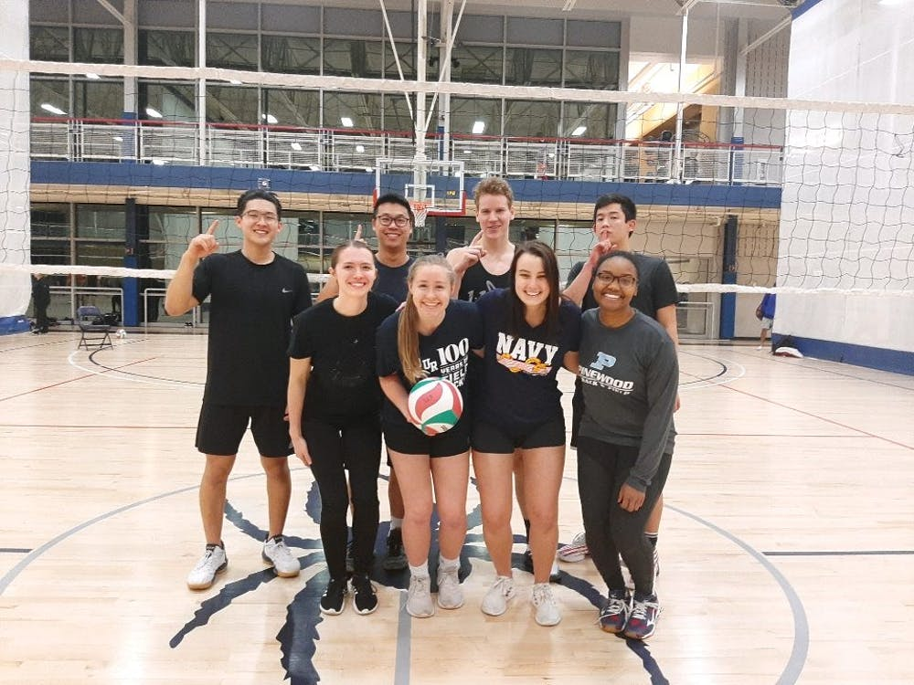 Cru members (from top left to bottom right) Ephraim Kang, Gavin Foo, Nate Lyell, Nick Yamasaki, Margaret Grigsby, Esther Helm, Peyton Annoni and Faith Pinckney after an intramural volleyball game.