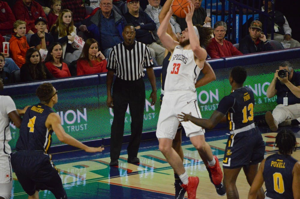 <p>Sophomore forward Grant Golden drives to the basket in a loss against La Salle. Golden finished the night with 12 points and six rebounds.</p>