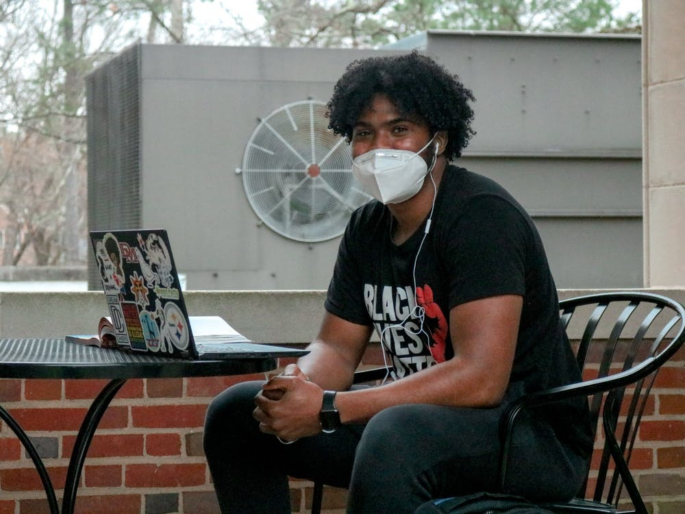 Senior Beau English watches the protest outside Richmond hall.