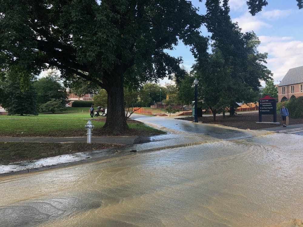 Water from a pipe outside of Sarah Brunet Hall overflowed onto Richmond Way near the Carole Weinstein International Center on Monday afternoon.