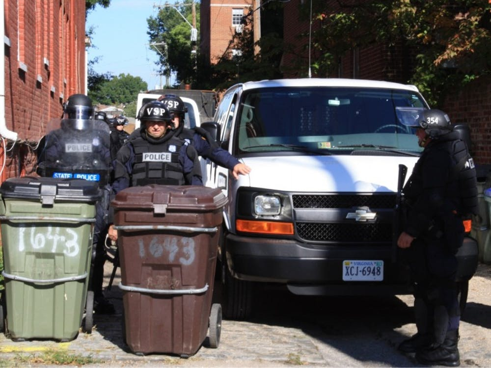 Virginia State Police adorn riot gear and cordon off streets in preparation for the rally.