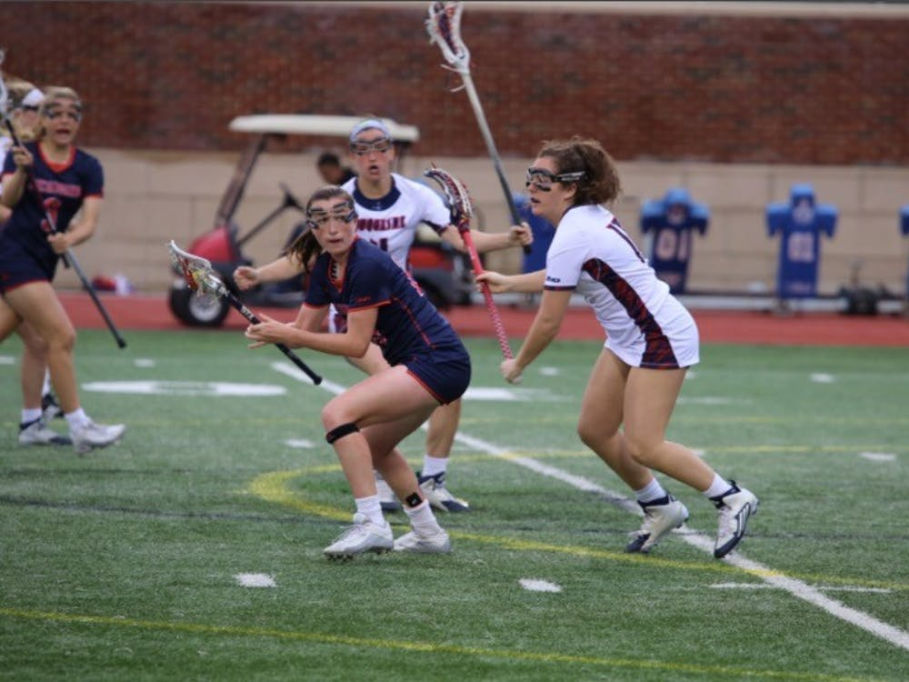Senior Kathleen Berkery, who decided to quite the lacrosse team, dodges a defender during an in-season game against Duquesne. Photo courtesy of the A-10 network.