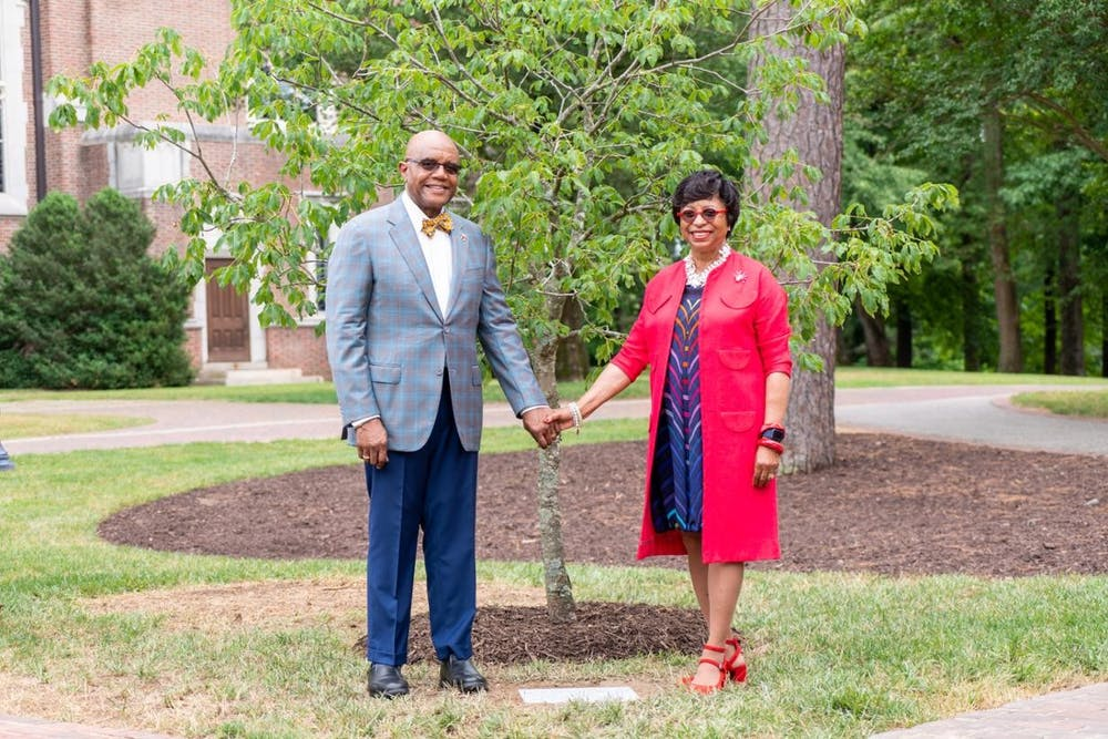 <p>Ronald and Betty Neal Crutcher pose in front of a buckeye tree dedicated to Betty Neal on June 10. <em>Photo courtesy of the University of Richmond.&nbsp;</em></p>