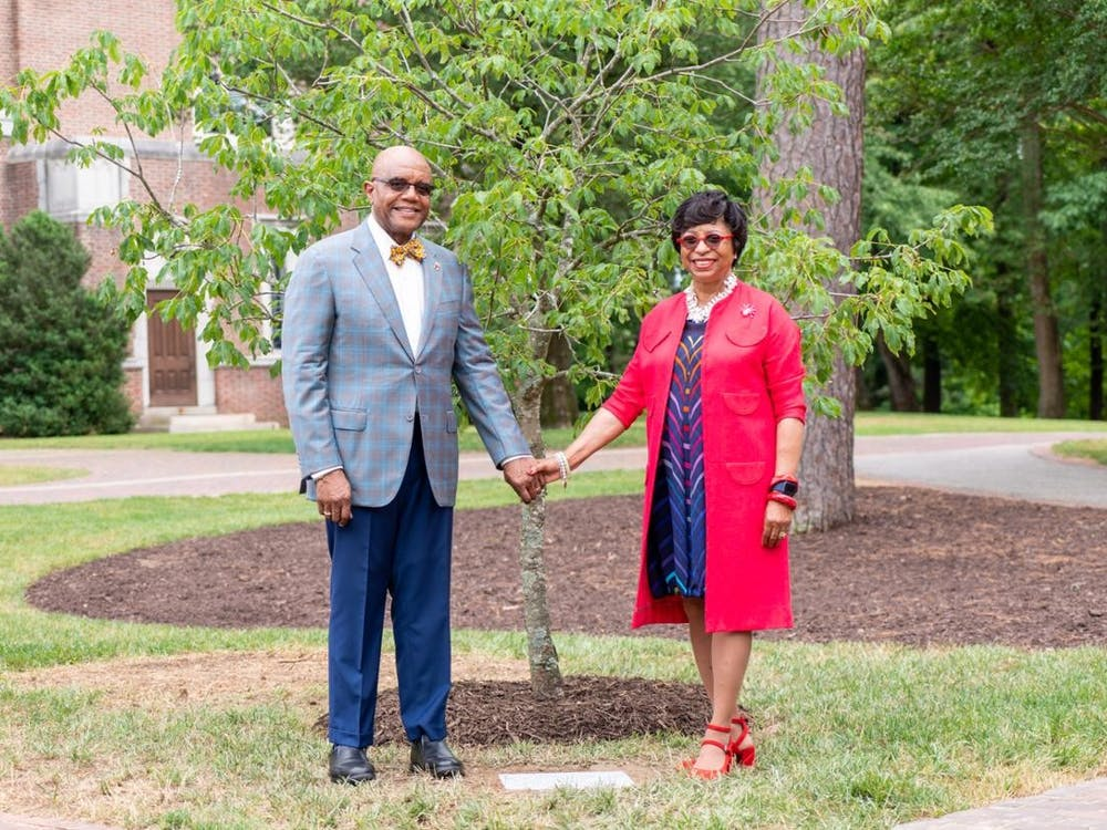 Ronald and Betty Neal Crutcher pose in front of a buckeye tree dedicated to Betty Neal on June 10. Photo courtesy of the University of Richmond.