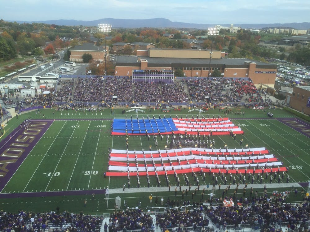 JMU's marching band performs the National Anthem in anticipation of today's game at 3:30 p.m.