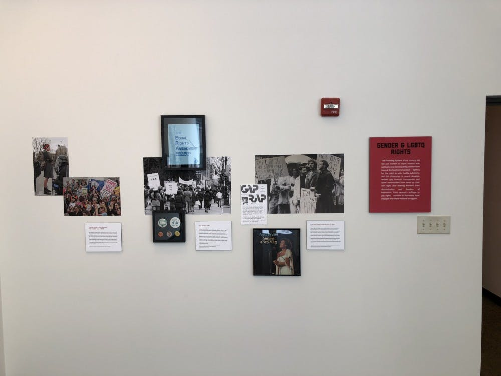 Pictures and artifacts from protests on gender and LGBT rights at the exhibit.