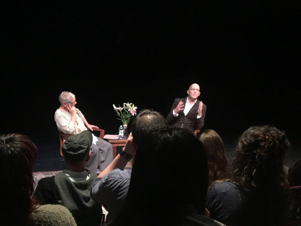 <p>Talyor Mac (right) speaks to Dorothy Holland as part of an artist's talk for&nbsp;the University of Richmond's Tucker-Boatwright Festival of Literature and the Arts on Thursday night.</p>