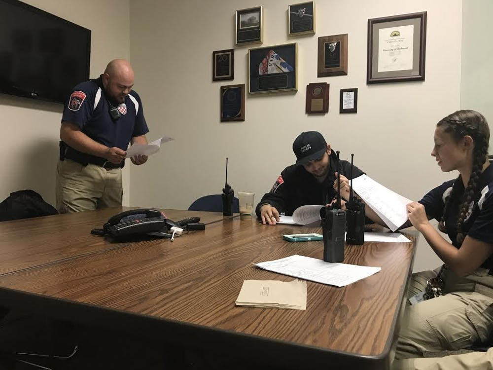 PSAs Kyle Linardo, Ayush Malik and Maddie Bright debrief at the URPD headquarters before heading out for patrol.