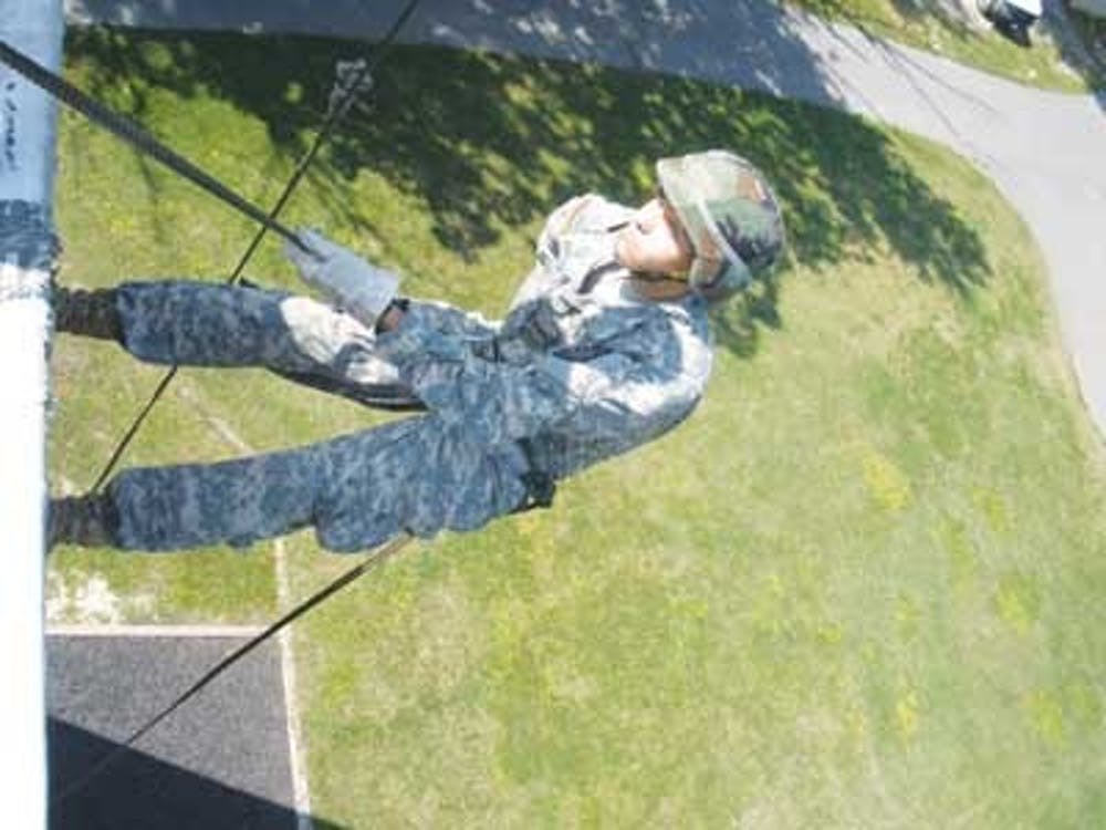 University of Richmond sophomore Brad Praskach scales a 50-foot Rappel Wall at Fort Lee during the Reserve Officers' Training Corps Leadership Lab in Norfolk, Va.