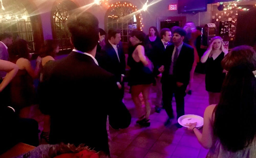 <p>Members of College Republicans and College Democrats mingle with one another during their joint social.&nbsp;</p>