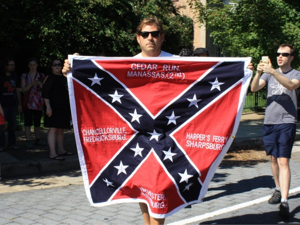 After the Tennessee group left at 10:45 a.m., a man carrying a Confederate flag walked to the front of the crowd. Police soon created a barrier to protect him.