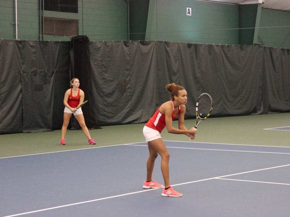 Richmond freshmen Kiana Marshall and Lyndell Giffenig prepare for a long match against Navy's Catalina Rico and Aimee Dervishian.