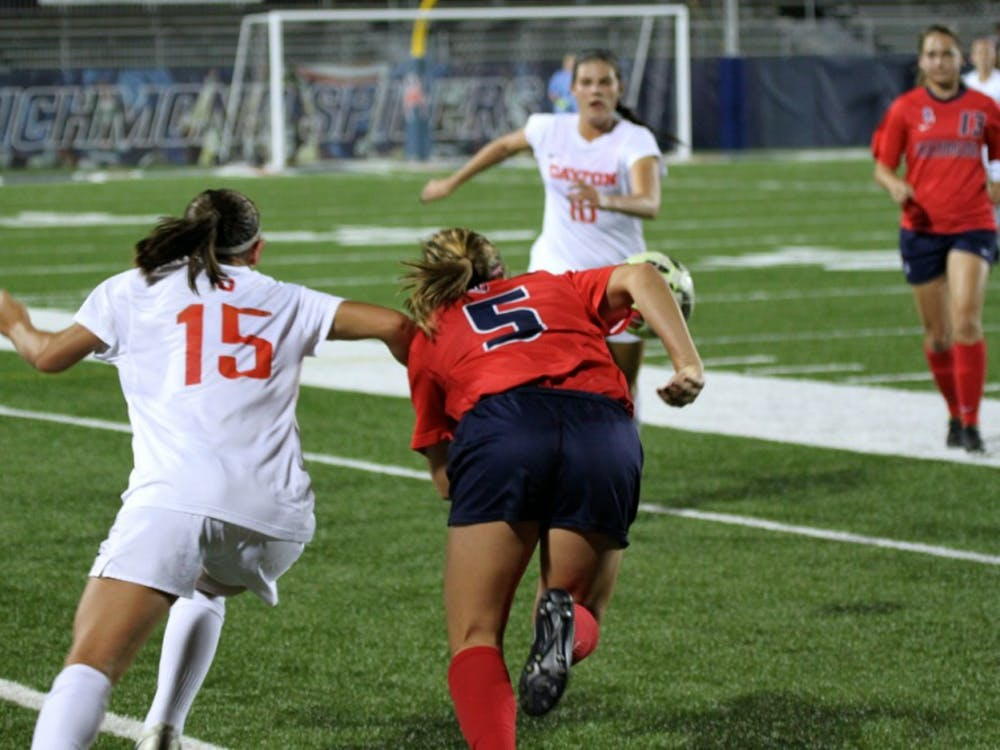 Richmond forward and athlete of the weekMeaghan Carrigan fights for possession.