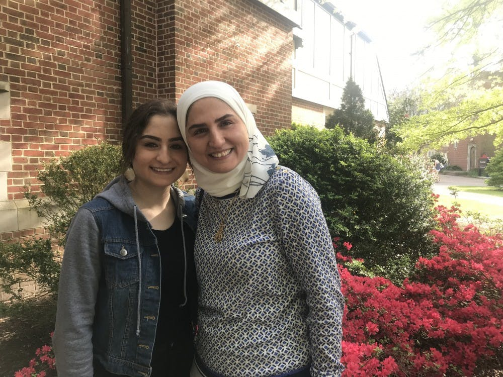 Sana Mouayd Azem (left) and Maysaa Alsous, her mother, pose for a photo.