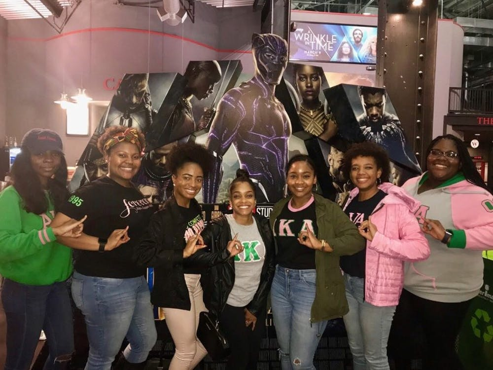 The Refined Roses of the Rho Mu chapter of Alpha Kappa Alpha Sorority, Inc., pose for the free Black Panther screening sponsored by the office of multicultural affairs. Photo courtesy of Davina Adderley