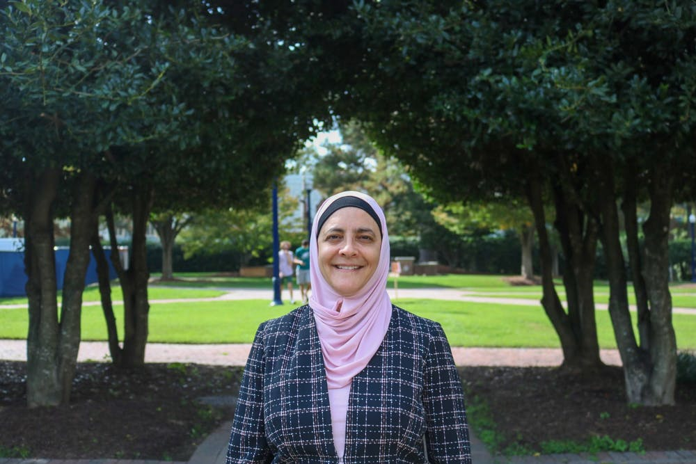 <p>Rana Dajani stands outside the Jepson School of Leadership Studies, where she is currently teaching as a Zuzana Simoniova Cmelikova visiting scholar in Leadership and Ethics.</p>