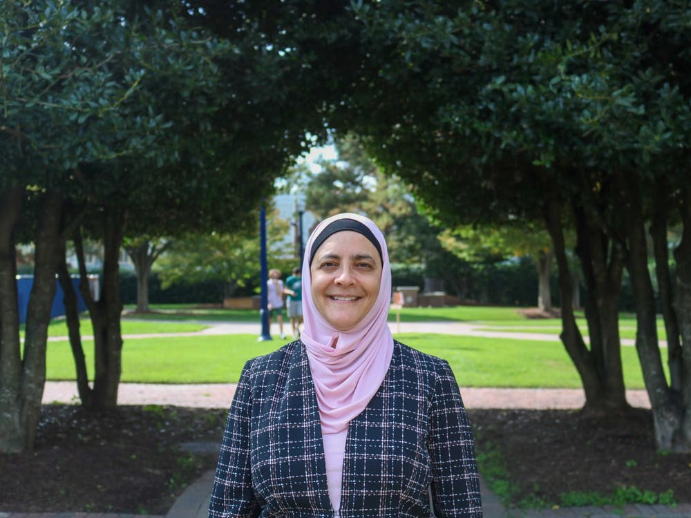 Rana Dajani stands outside the Jepson School of Leadership Studies, where she is currently teaching as a Zuzana Simoniova Cmelikova visiting scholar in Leadership and Ethics.