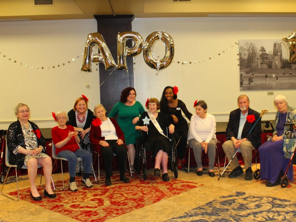 Manorhouse Assisted Living & Memory Care residents pose for a group photo. Image courtesy of Fatema Al Darii