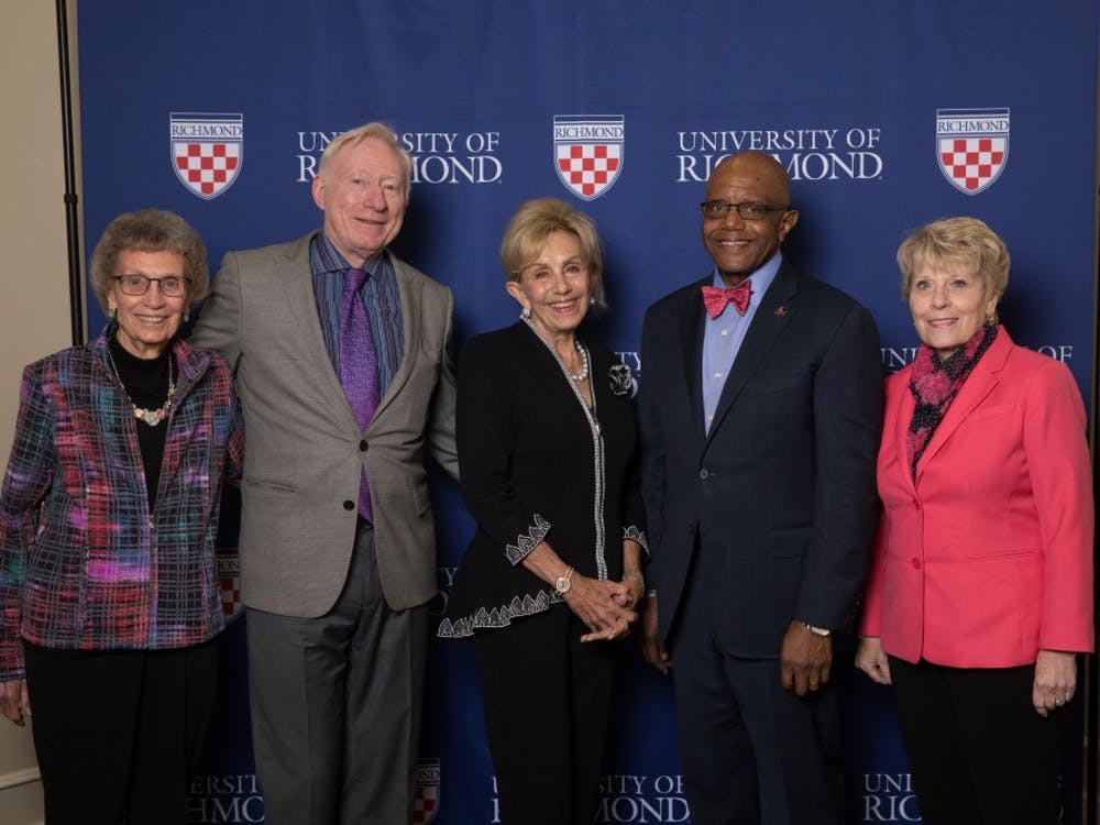 Founding members of the University of Richmond's WILL* program stand with President Ronald A. Crutcher (fourth from left). Photo courtesy of Holly Blake