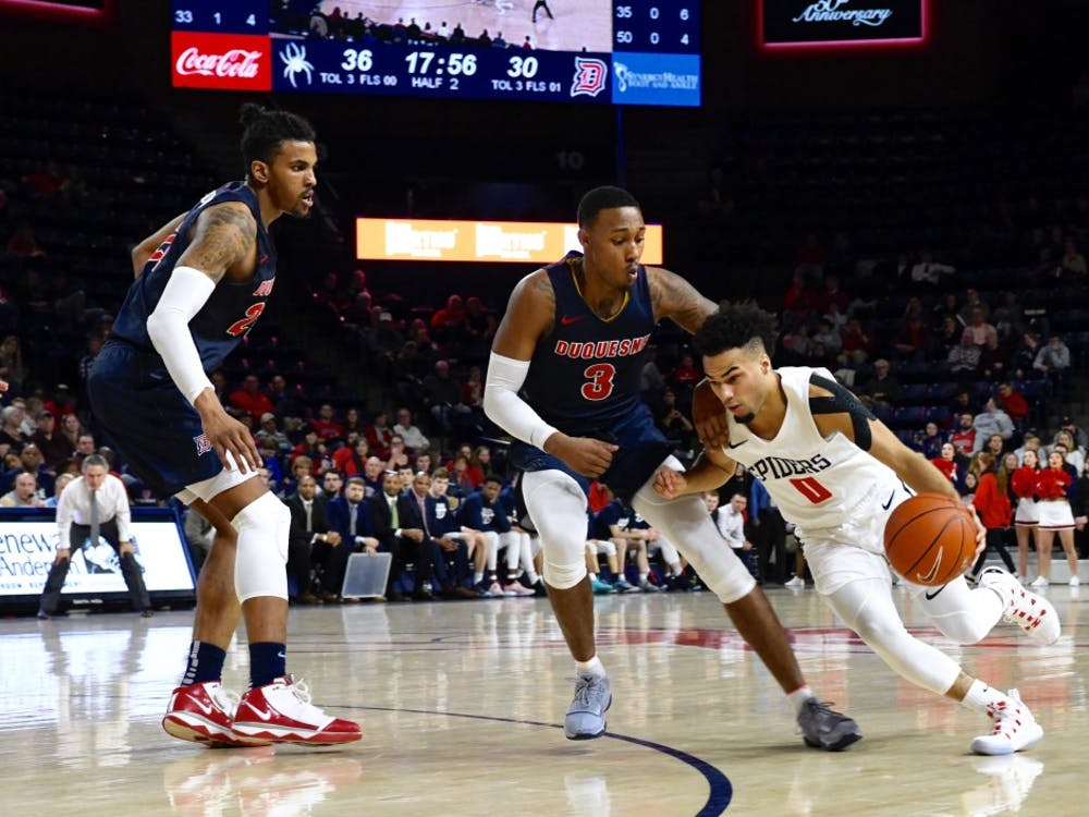 Sophomore guard Jacob Gilyard drives to the basket against Duquesne. He scored 22 points in the Spiders' loss.