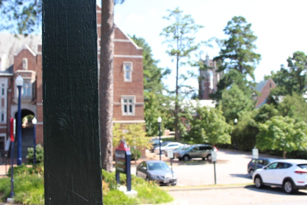<p>According to images on Twitter, a white supremacist group appeared to have placed one of the stickers on this wooden post, located near Weinstein Hall.&nbsp;</p>
