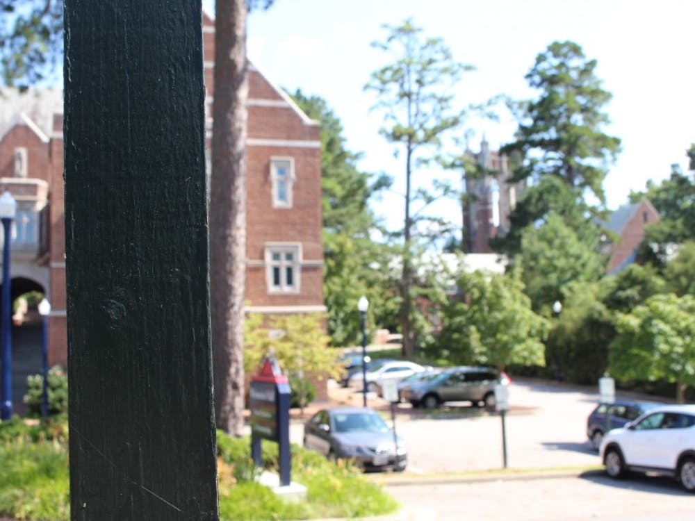 According to images on Twitter, a white supremacist group appeared to have placed one of the stickers on this wooden post, located near Weinstein Hall.