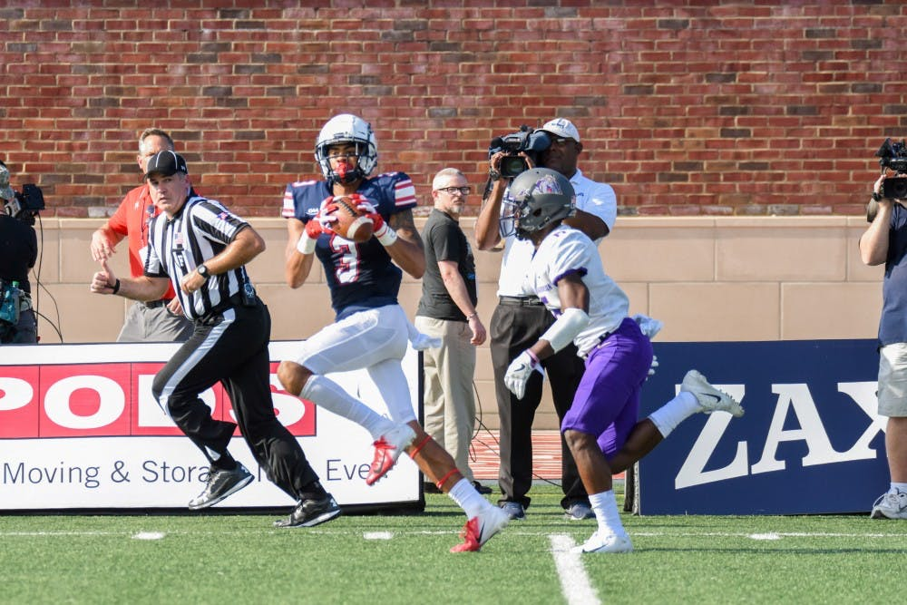 <p>Redshirt senior wide receiver Jarmal Bevels catches a pass Saturday against James Madison University. Bevels had one reception for 50 yards in a Spiders loss.&nbsp;</p>