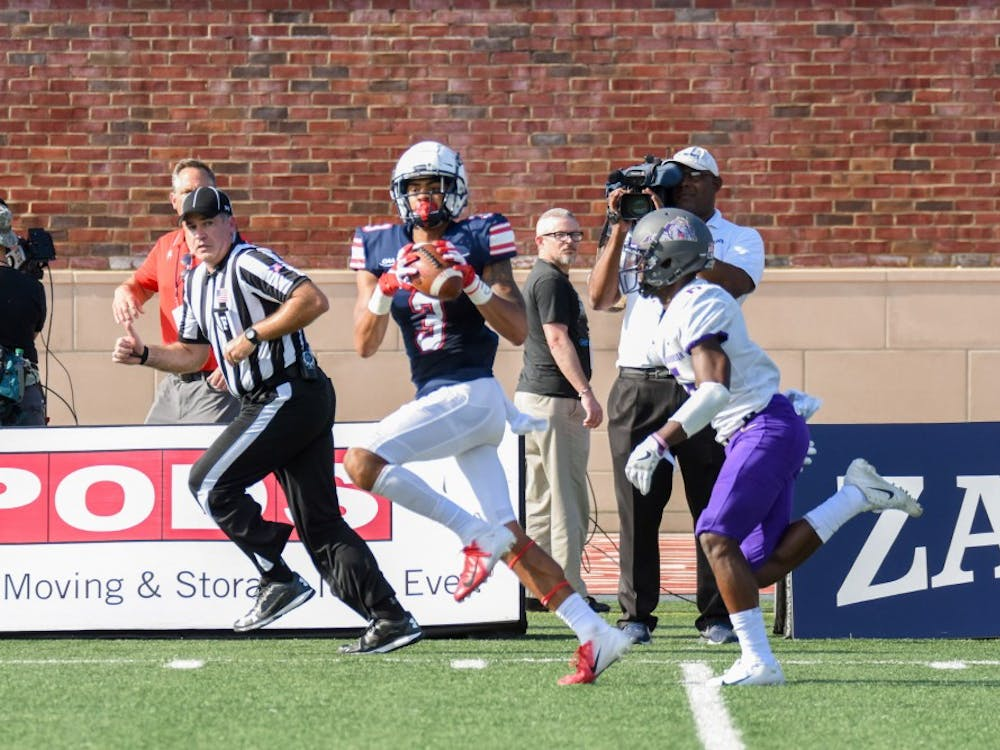 Redshirt senior wide receiver Jarmal Bevels catches a pass Saturday against James Madison University. Bevels had one reception for 50 yards in a Spiders loss.