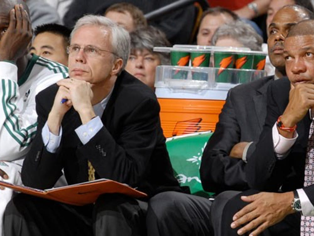 Kevin Eastman (second from the left) on the Celtics bench. Photo courtesy of the University of Richmond Newsroom.