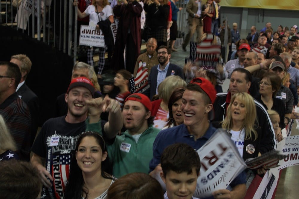 <p>Young Trump supporters walk around at a rally in Richmond last year.&nbsp;</p>