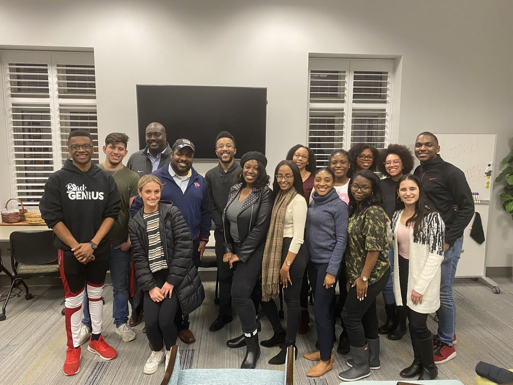 "<p>Current students and alumni pose for a photo at BSA's ""Untold Stories: Voices of Black Alumni"" panel event. The event took place on Monday, Feb. 10, 2020.&nbsp;</p>"