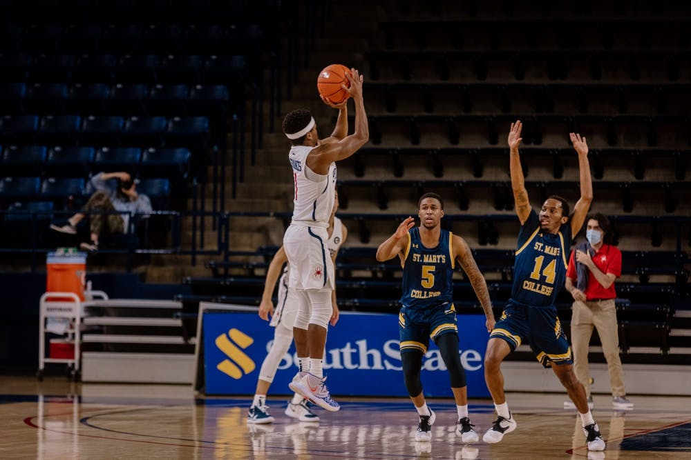 <p>Graduate Student forward Blake Francis takes a shot over a defender during a game against St. Mary's College on February 14th. <em>Photo courtesy of Richmond Athletics</em></p>