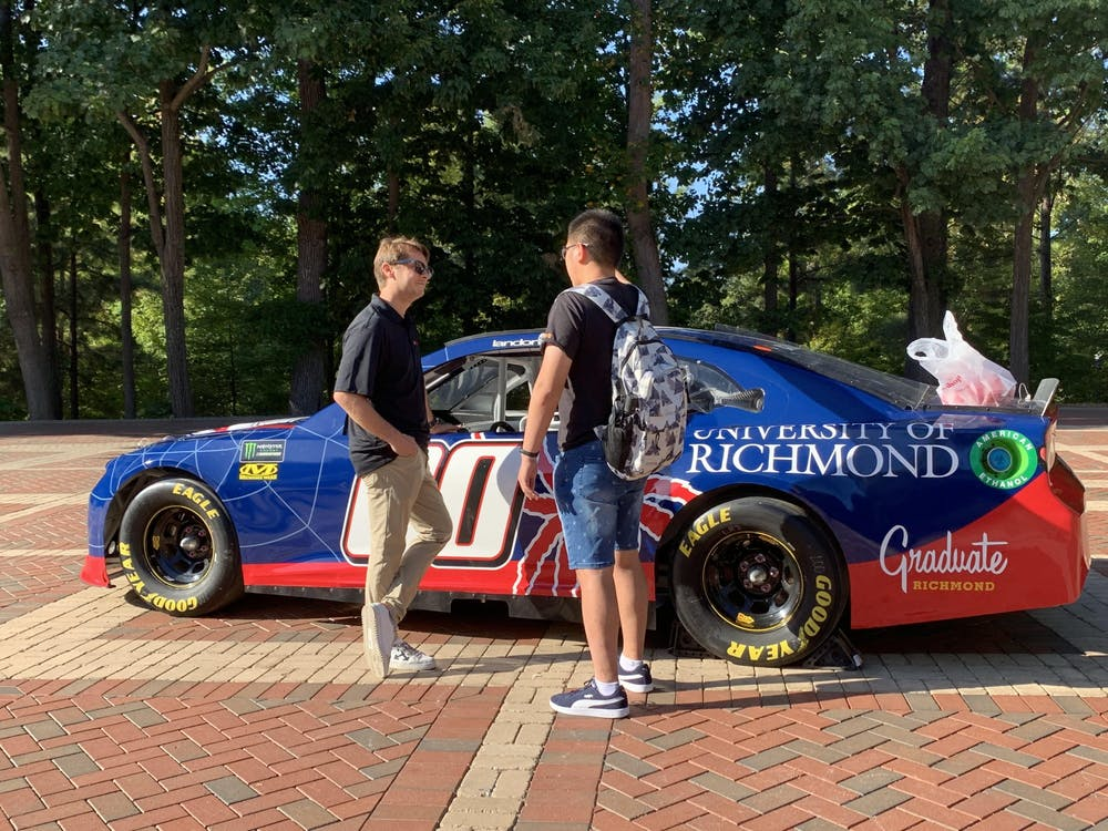 Driver Landon Cassill, left, chats with a student in the Forum on Thursday, Sept. 19, 2019. The University of Richmond sponsored a car in the race at the Richmond Raceway on Sept. 21 and had a public showing of a replica model on campus.