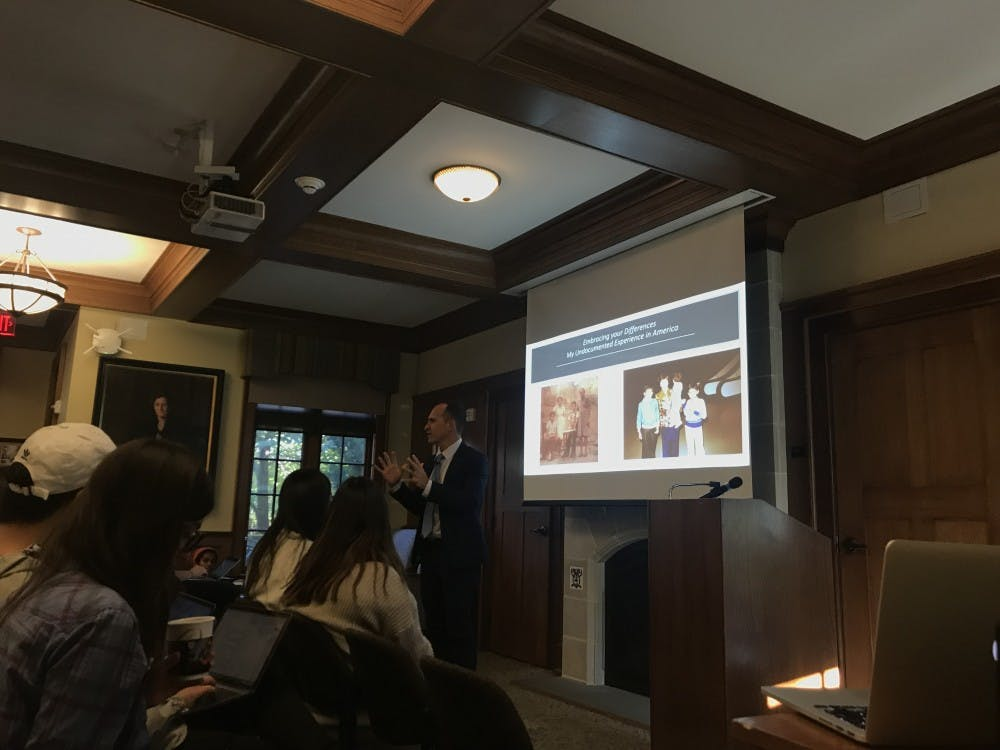 Dr. Harold Fernandez speaks to a room full of students and professors about his journey to America and life afterward as an undocumented immigrant on Tuesday, Oct. 30.