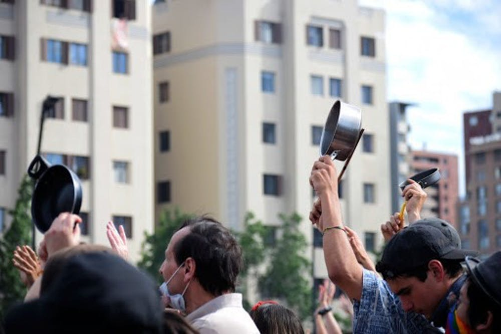 "<p>Protestors in Santiago, Chile hit pots and pans in a common form of protest called ""cacerolazo.""</p>"