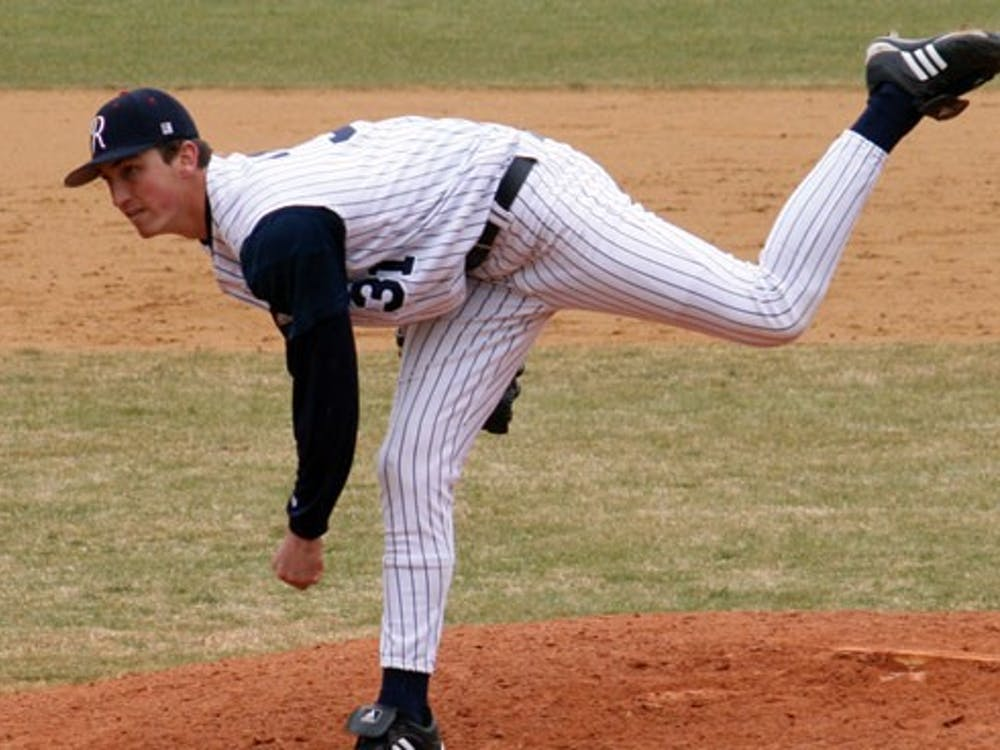 Daniel Clark (# 31) warms up before the 7th inning and practices pitching